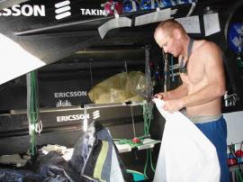 David Rolf repairs a sail : © Ericsson Racing Team